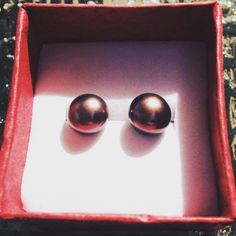 14k yellow gold Chocolate pearls stud earrings $136.00 Only 1 available Handmade item Primary color: Chocolate Brown Holiday: Valentine's Day Materials: 8mm, Yellow gold, 14k, Chocolate pearls Ships worldwide from United States Favorited by: 1 person  https://www.etsy.com/listing/496082660/14k-yellow-gold-chocolate-pearls-stud?ref=related-4#