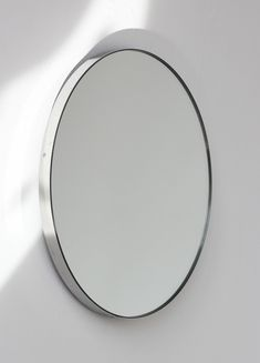 "Delightful hand crafted silver round mirror with an elegant stainless steel frame.  Ideal above a console table in the hallway, above a beautiful fireplace, in the bedroom or in the bathroom.  Design tip: looks stunning used as a cluster in different sizes and/or colours.  Framed mirror available in 20cm/7.9"", 40cm/15.8"", 50cm/19.7"", 60cm/23.6"", 79cm/31.1""  100cm/18.55"" (depth 18mm)."