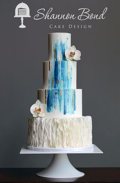 White wedding cake with water color blue and gold streaks