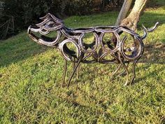 Pig horseshoe sculpture.  I LOVE LOVE LOVE this!!!!! WELDING PROJECT?!