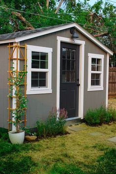 A Cozy Shed - simple ladder trellis from The Home Depot turned into corner trellis - cut in half and attach to side of the cottage using a nail gun - add potted honeysuckle