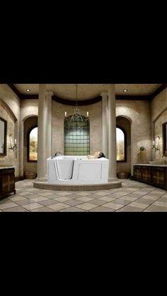 I love the colors and columns enclosing bathtub area.