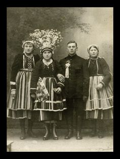 "Folk costume from Łowicz, Poland - bride in traditional ""flower crown"" in the middle. Archival photograph (date unknown)."