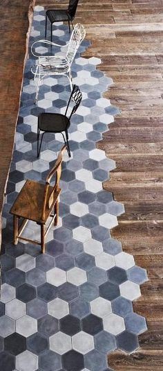Old factory converted to industrial home - Reclaimed wood floors with hexagonal cement floor tiles