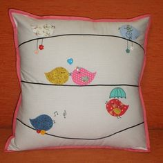 Cute birds on a wire pillow- especially love the bird with the umbrella, the lovebirds, and the bird whistling out music notes!