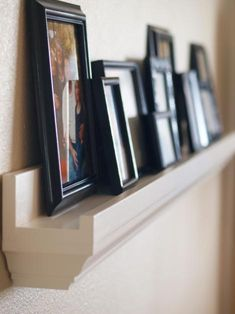 $10 photo ledge.  As a person who likes to tell the story of our family in photos I have way more pictures that I love than I could ever display.  This is a great way to get a ton of photos displayed without taking up a whole wall with picture frames!