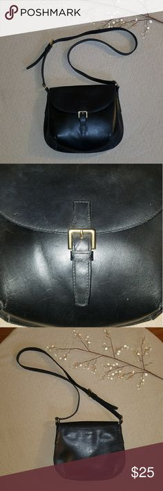 Leather Cross Body Purse This is a black leather cross body with a decorative buckle. The actual closure is a snap beneath the buckle strap. G. H. Bass & Co brand. Used, some small scratches or marks in leather, as can be seen in pics.  Thanks for stopping by my closet! Bundle and save! Don't be afraid to make an offer or comment with any questions. Bass Bags Crossbody Bags
