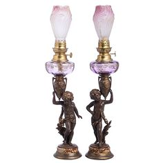 Pair of candlesticks/oil lamps