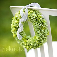 The outdoor space needed little decor, so Susan just made wreaths to hang on the aisle seats.