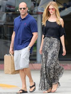 Rosie Huntington-Whiteley goes bra-less in a flowing animal-print maxi as she enjoys lunch date with Jason Statham | Mail Online