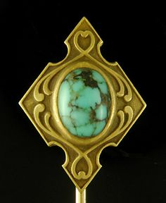 A striking turquoise floats like a small planet amid swirling curves.  A beautifully crafted stickpin in 14kt gold by Hayden W. Wheeler & Co.,  circa 1900.