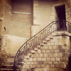 Beautiful stone and wrought iron staircase at Chateau du Henri IV, Nerac.