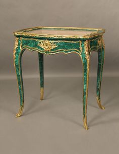 A Fine Quality Late 19th Century Gilt Bronze Mounted Louis XV Style Malachite Vitrine Table   By François Linke