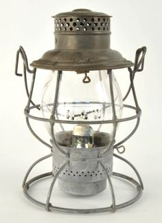 """Adlake Reliable tall globe lantern for the Norfolk & Western Railroad with last patent date 1913. Lantern body is unmarked, clear CNX cast globe is marked N&W. size: 10.5"""" t."""