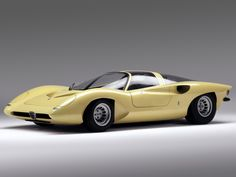 1969 Alfa Romeo P33 Coupe. Interesting choice of color but you can't argue with the design.