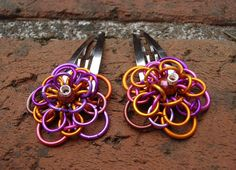 Chainmaille Dahlia Flower Set of Two Barrettes Carnival Colors with Bronze Pearls. $25.00, via Etsy.