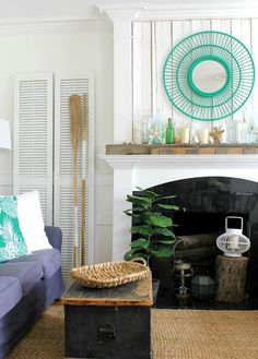 These fireplaces are decorated with sea inspired coastal theme focal points such as this turquoise mirror above the fireplace and a mantel with oceanic bottle vase. To see many more fireplace decorating ideas with a coastal theme click over to Completely Coastal.