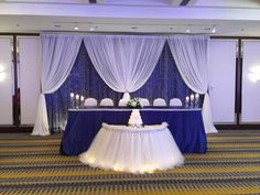 Blue backdrop with crystals & white chiffon swags