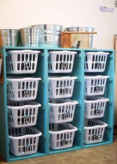 I have storage cubbies like this in my basement/laundry room! im sooo putting baskets to organize it lol