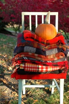 cozy fall blankets with a pumpkin to weigh them down