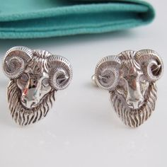 """🎉HP🎉 TIFFANY & CO RARE SILVER RAM CUFF LINKS AUTHENTIC TIFFANY & CO RARE SILVER RAM SHEEP GOAT CUFF LINKS !  ABSOLUTELY STUNNING!!!!  Engraving: """"T&CO 925""""  100% AUTHENTIC & RARE!!! """"SS Fordham Ram Cufflinks"""" in original box and packaging. Box slightly damaged but links never worn. Comment with any questions or if interested. Everything comes from a smoke & pet free home. No trades. If you're interested make an offer! No lowballing!! 🎉Style Obsessions Host Pick🎉 Tiffany & Co. Jewelry"""