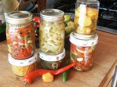 I have made good pickled peppers from Santa Fe Grande, Hungarian hot, red hot cherry, jalapeno, serrano and habanero chiles.  Makes about 6 pints.  Wash the peppers and cut the stems from the large...