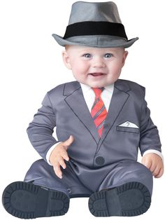 All Business Baby Suit Costume - This is a wonderfully cute and snazzy suit for your little one. This baby means business. This is a two-piece costume with a one-piece and a hat. The one piece suit covers the arms and legs. It opens up from the back of the collar with a Velcro fastening and also opens up from the inner seam of the pants. It has metal snaps to close up the pants. #business #baby #suit #uniform #calgary #yyc #costume
