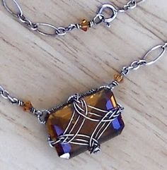 Wire Wrap Jewelry -- individually wire wrapped! i love Celtic 'look' designs and braiding... Seen similar before, but this is very very well done. love the frame and i wonder how large it is?