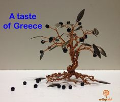 The ultimate #Greek product. An #olive tree made of cooper wire, metal bronze leaves and black plastic beads for olives. — www.artingclub.eu