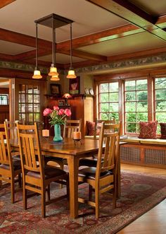 Hung above a high wainscot, the fill paper and narrow frieze in soft greens complement the fir woodwork in the dining room. The table and chairs are reissues by Stickley. 1909 bungalow in Portland. Craftsman Dining Room, Dining Room Wainscoting, Craftsman Interior, Craftsman Style Homes, Craftsman Bungalows, Craftsman Style Interiors, Craftsman Style Furniture, Wainscoting Nursery, Painted Wainscoting