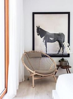 Wegner Style Circle Chair: Triple sanded solid hardwood forms the strong and smooth frame of this bohemian-chic chair. It has been crafted by hand, and wheels have been added to the back legs to allow the piece to be moved with ease, without damage to floors.