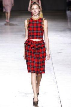Simone Rocha, Fall 2014 RTW (style.com): red plaid skirt w/ flounce at waist; red plaid tank top w/ gold braid trim at neck line & armscye
