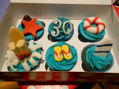 Cupcakes in a surfer theme for a 30th birthday.