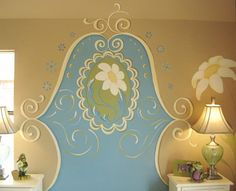 Paint a headboard to a wall for a girl's room.