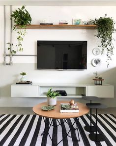 Living room designed by @ gleuse.architecture with wall painted by half . Simple Living Room Decor, Living Room Decor Inspiration, New Living Room, Small Living Rooms, Home And Living, Small Living Room Ideas With Tv, Living Room Tv Unit Designs, Shelf Above Tv, Home Decor