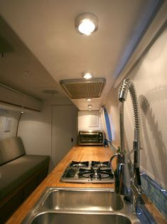 Airstream kitchen with butcherblock countertops.