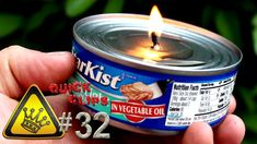 A can of tuna and a piece of paper towel form a makeshift oil-lamp that burns for 2-3 hours. Bonus: You can still eat the Tuna afterward.