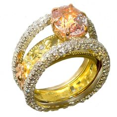 Orange-Yellow Sapphire Diamond Gold Ring | From a unique collection of vintage cocktail rings at https://www.1stdibs.com/jewelry/rings/cocktail-rings/