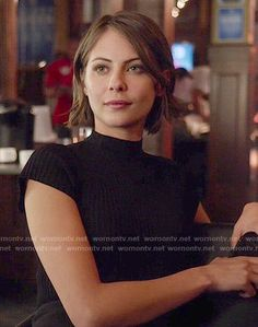 Thea's black mock-neck top on Arrow.  Outfit Details: http://wornontv.net/53625/ #Arrow