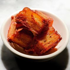 "Crispy layered potato - ""little golden boxes made of thin rectangles of potato stacked like Post-it notes, then fried in beef fat""."