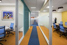 Milliken's Formwork in Tangerine lays the ground for an inspiring experience at Home for Little Wanderers. #flooring #carpet #designinspiration #corporatedesign #floorcovering