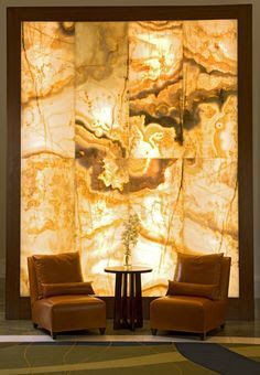 Trending Now - The Best Gold Furniture For Your Luxury Interior Design Onyx Marble, Marble Wall, Stone Interior, Luxury Interior Design, Salas Home Theater, Deco Spa, Stone Wall Design, Gold Furniture, Yellow Interior