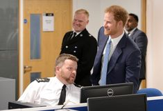 Prince Harry Photos Photos - Prince Harry meets Inspector Paul Gummer (left) at the opening of Nottingham's new Central Police Station on October 26, 2016 in Nottingham, England. - Prince Harry Visits Nottingham
