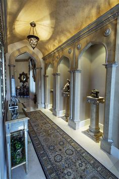 Gothic style hallway with Indian accents ~ Interior design by Howard Firth