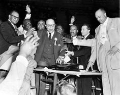 """Surprisingly, in this photo that ran June 20, 1958, Martin Luther King Jr., just right of center, wasn't the focus. Dr. O. Clay Maxwell, a 73-year-old New York City pastor, center, had just been elected president of the National Sunday School and Baptist Training Union Congress in an election at the Civic Auditorium. King, who was 29 at the time, had taken over leadership of the congress when the previous president died a few months earlier. King gave the seconding speech for Maxwell at the election. The newspaper caption referencing the two men read, """"Age and youth combine."""" THE WORLD-HERALD"""