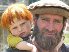Pashtun child and his dad in Nuristan (land of the light) Province in Afghanistan.