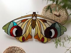 yeah! summertime is coming with this stained glass 'bigeye.moth' made in natural pied colors. i created this piece from my original drawing of a moth. the patina on the solder is done in black. this item is handcrafted by me from special stained glass which is cut by hand accurately and the edges are then ground smooth, cleaned and copper foiled. next, the pieces are perfectly assembled and soldered together. The final steps are to wash, polish & patinate the seams and wax the item. MEA...