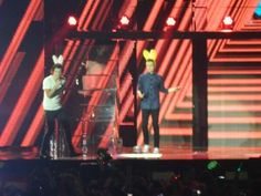 The boys on stage today for their concert in Liverpool. They are wearing bunny ears. #TMHtour