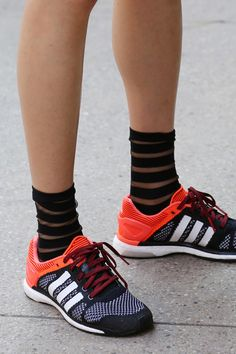 Striped dress socks surprisingly pair well with adidas sport shoes at #NYFW #SS15 #streetstyle