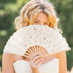 Functional yet elegant, this ivory lace folding hand fan will keep you and your bridesmaids cool and comfortable in gorgeous vintage style throughout your wedding ceremony and reception.